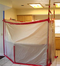 Picture of a very unprofessional attempt at building a mold removal containment area.